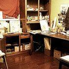 photograph of a cluttered artist's studio