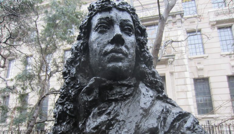 image is a close up on the face of a dark statue bust of Pepys