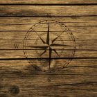 compass drawn on a wooden background