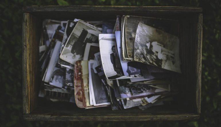 wooden box of vintage photographs