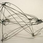 abstract wire sculpture in black, with lines and nodes - visual tension