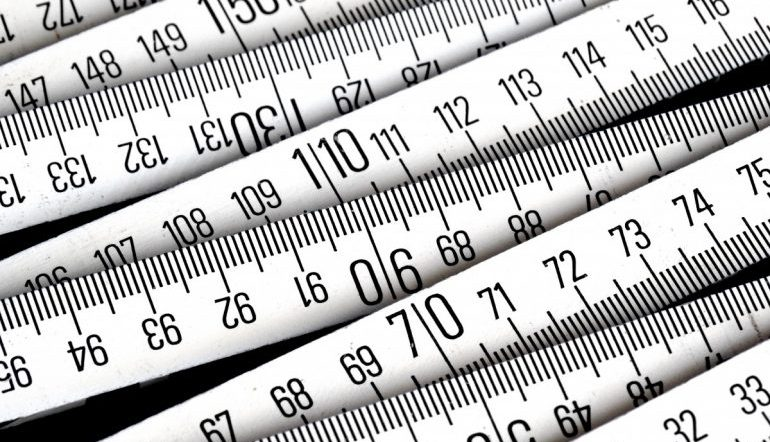 a series of black and white measuring tapes stacked on top of each other