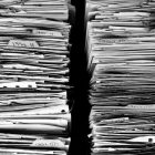 two stacks of paper/files
