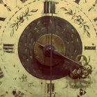 A zoomed in image of an old clock.