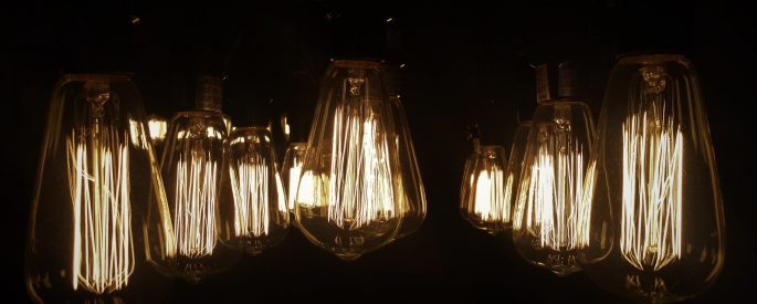 An image of multiple wire lightbulbs in the dark.
