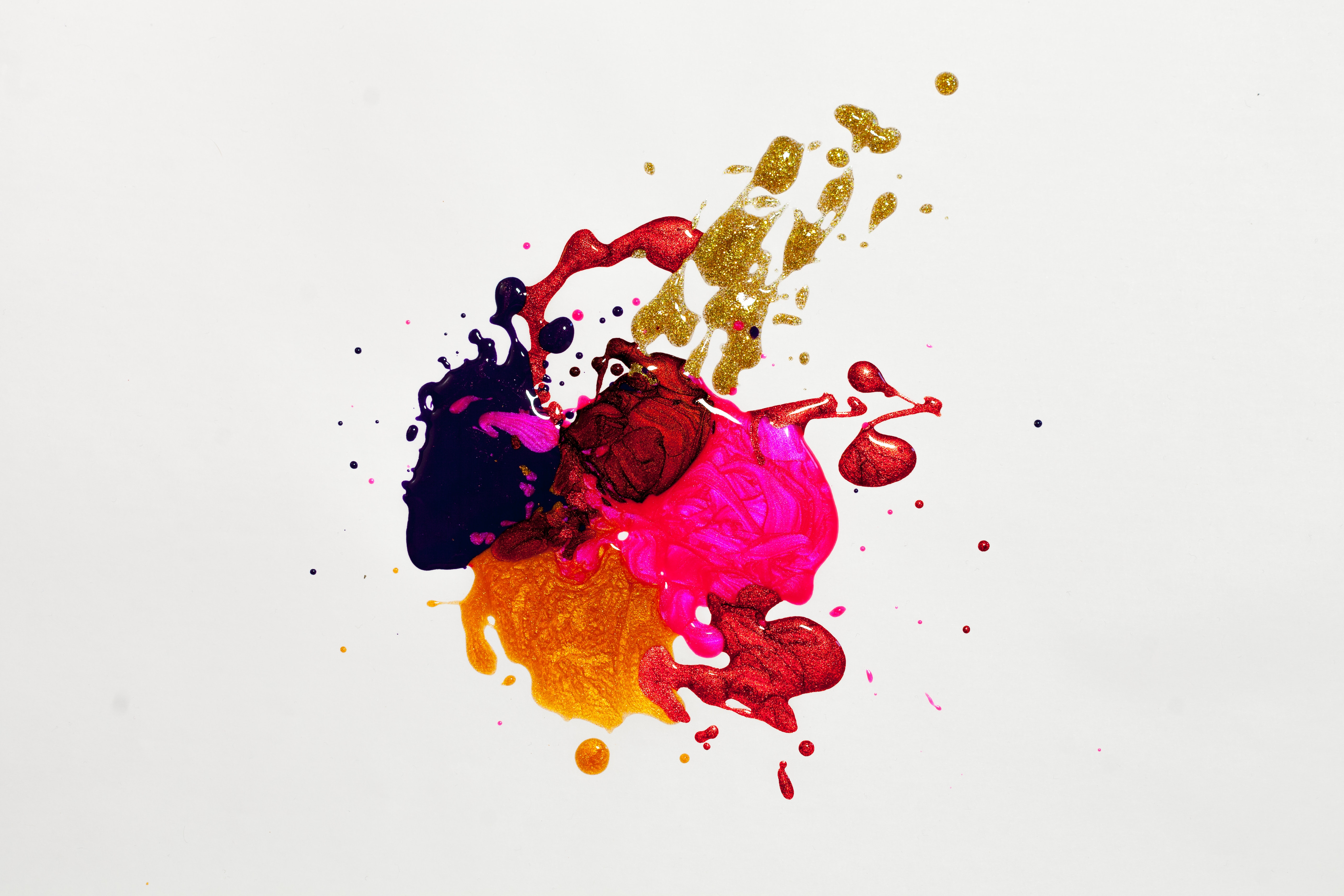 An image of an abstract painting - a centered paint splatter in various colors