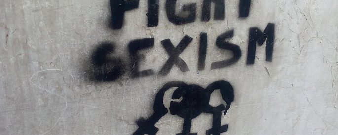 "Photo of graffiti on concrete wall reading ""Fight Sexism"""