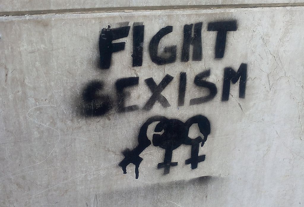 """Photo of graffiti on concrete wall reading """"Fight Sexism"""""""