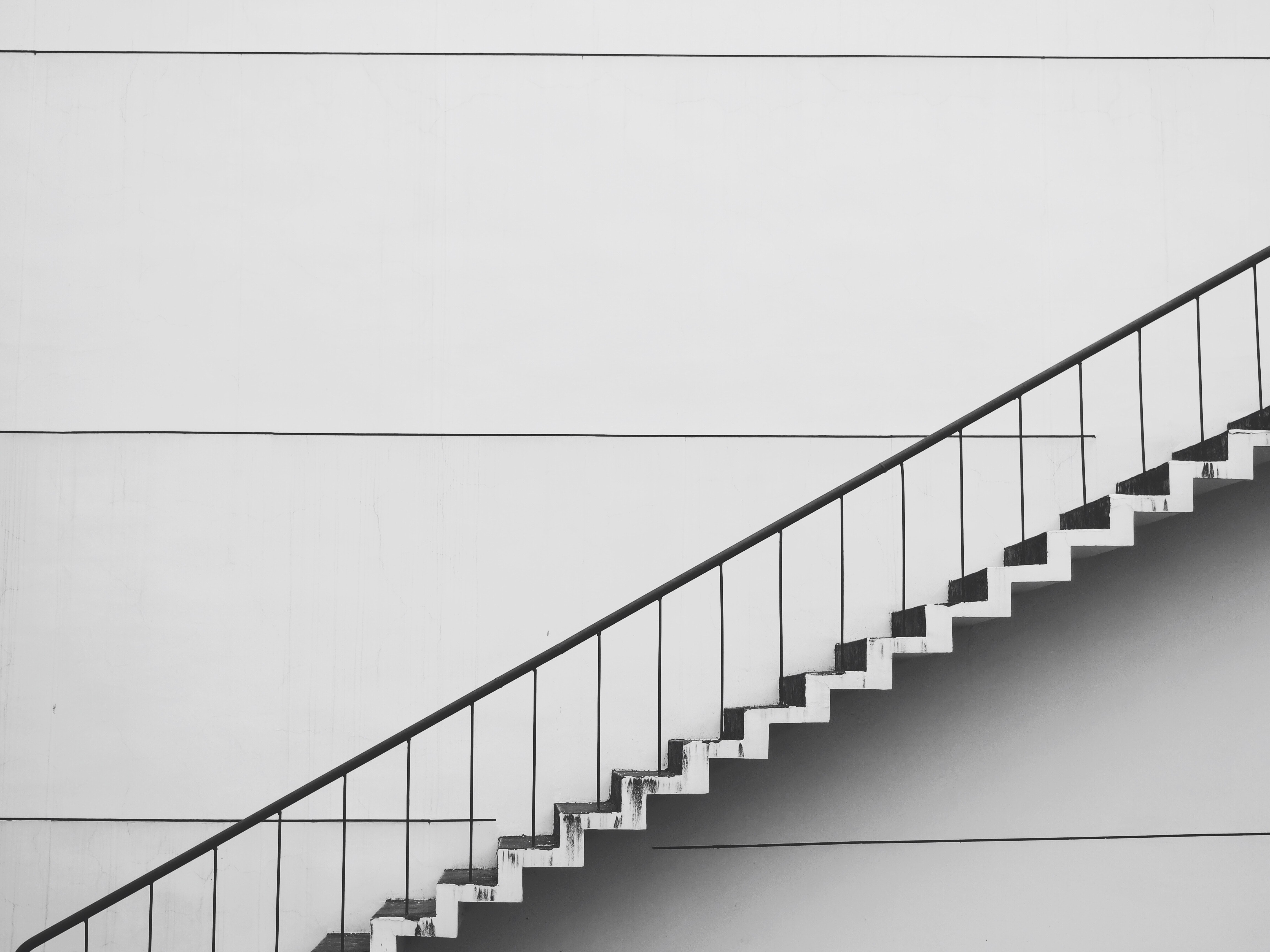 Photograph of a white, sleek staircase