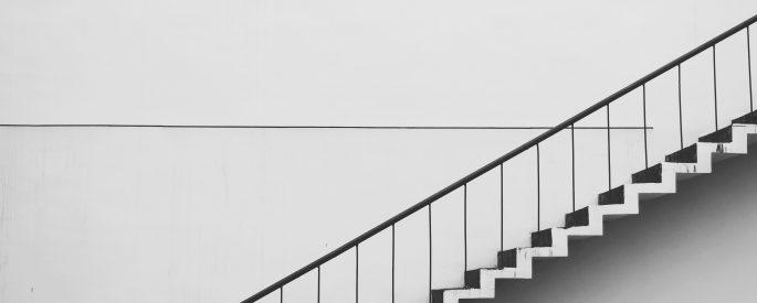 Photograph of a white, sleek staircase