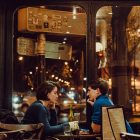 Image of a couple sitting at a table in a bar