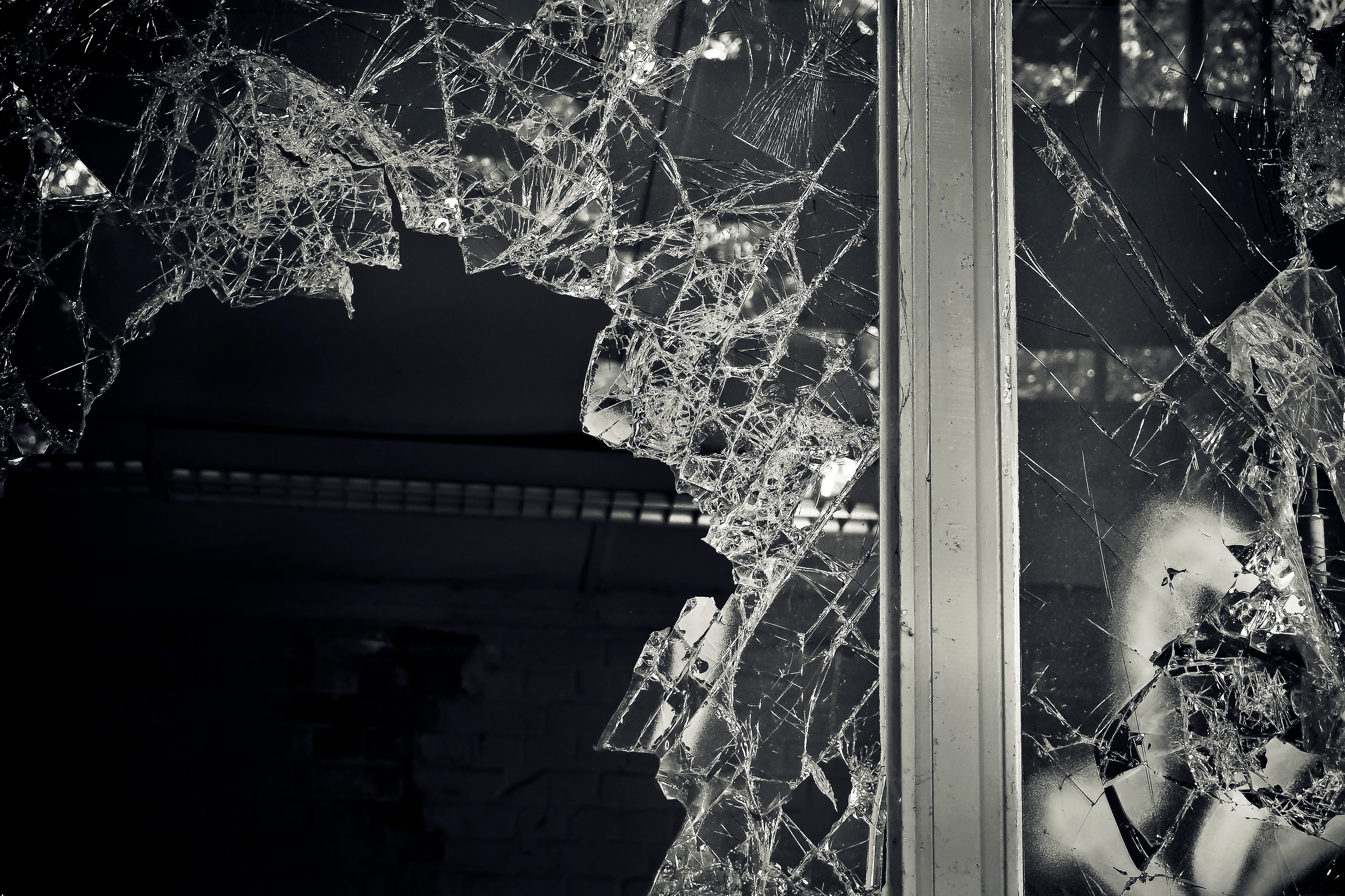 Black and white photo of a broken window