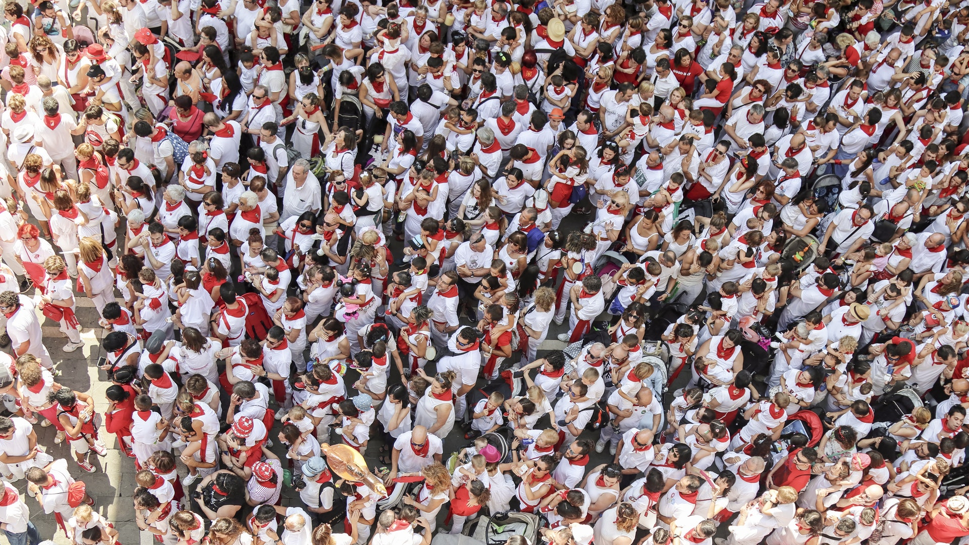 A bird's eye view of a crowd of people dressed in red and white