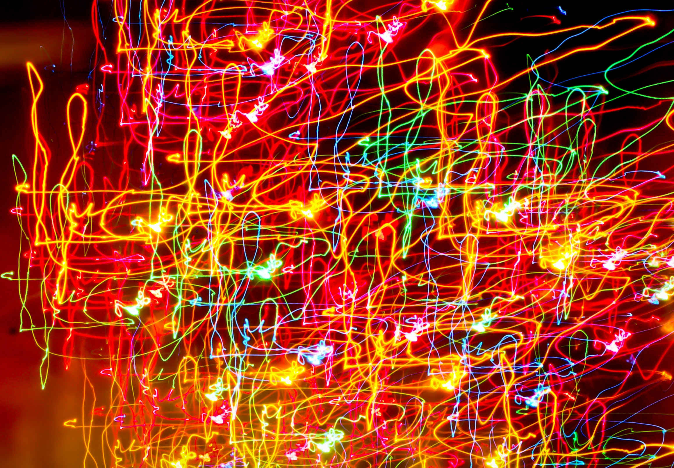Photograph of abstract art made by dozens of lines of neon light