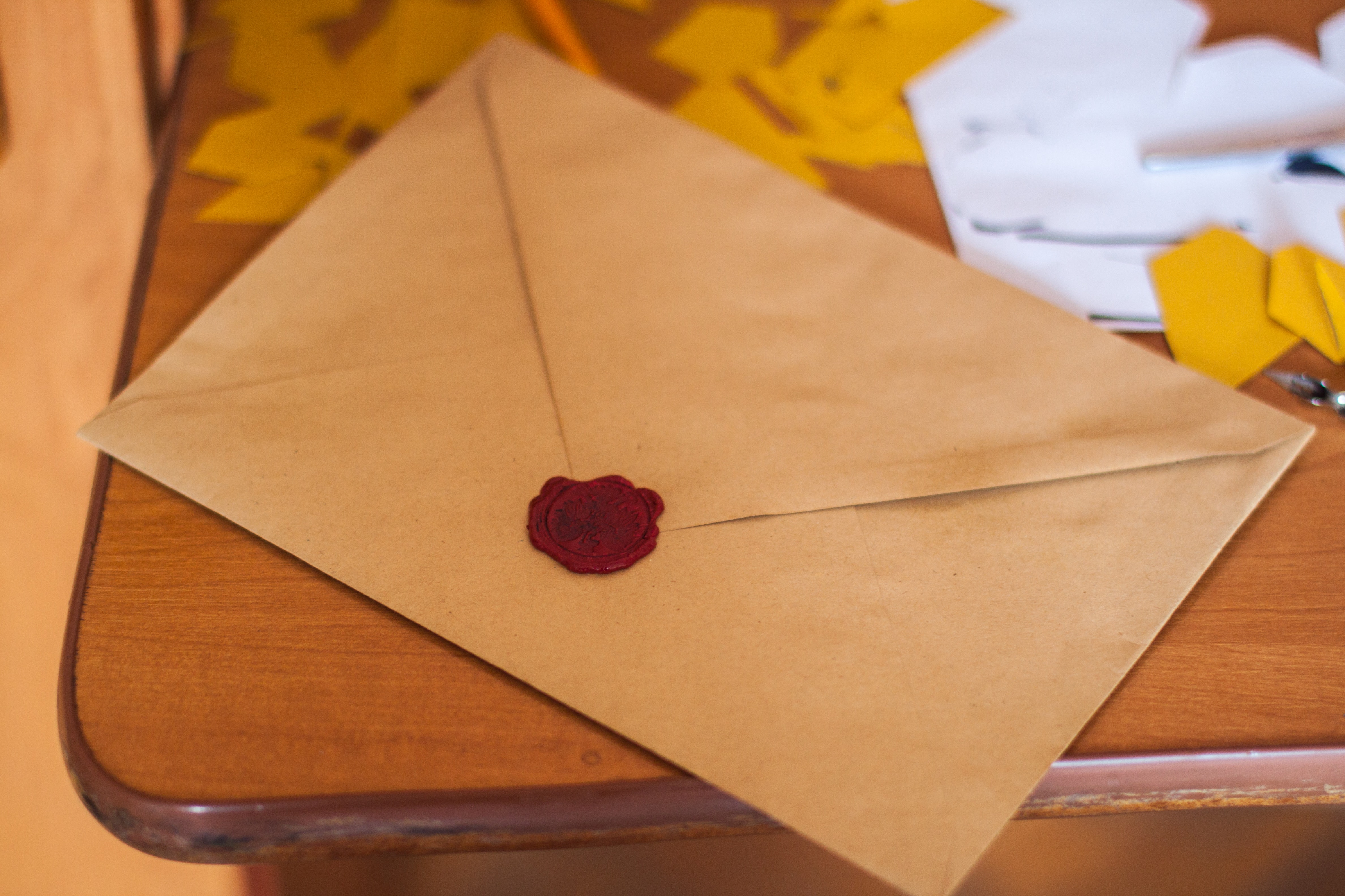 Image of a brown envelope with a red seal