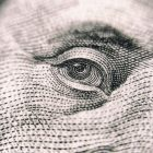 Closeup photograph if the eye on a US dollar bill