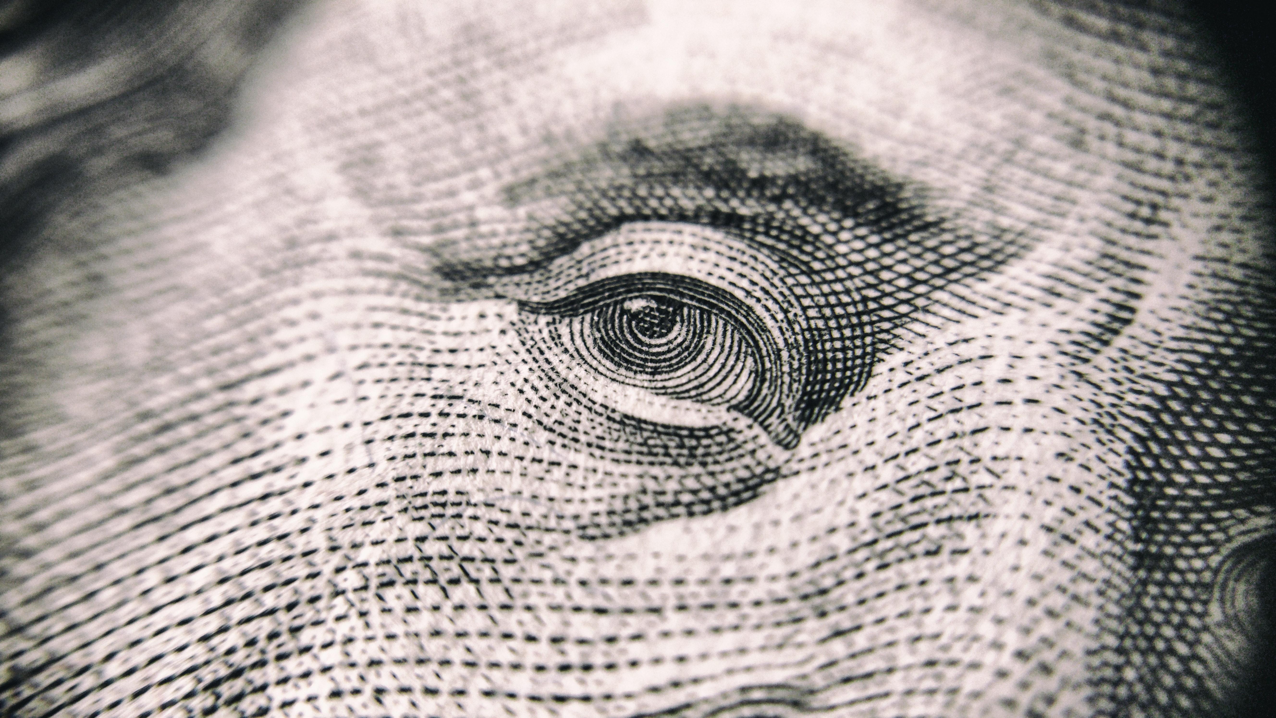 Closeup photograph if the eye on a US dollar bill