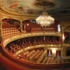 Photograph of the gold and red details of the inside of a theater