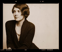 sepia portrait of Carrie O. Adams, who looks away from the camera