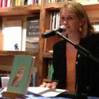 Megan Mayhew Bergman sits at a microphone in a bookstore