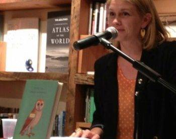 Megan Mayhew Bergman sits at a microphone in a bookstore