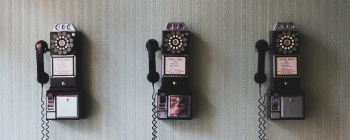 Three repeating rotary phones