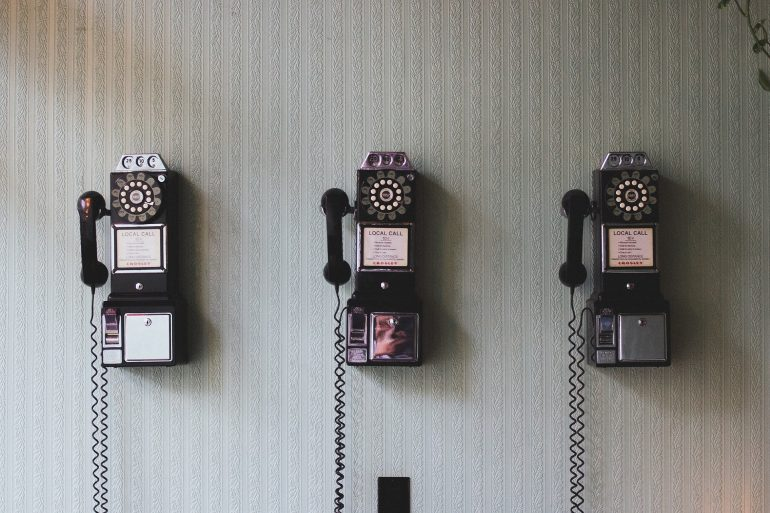 Three repeating rotary phones