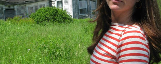 photo of Anna Stein O'Sullivan in a red and white striped shirt in sunglasses