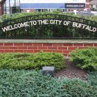 "photograph of a sign against wrought iron that reads: ""Welcome to the city of Buffalo"""