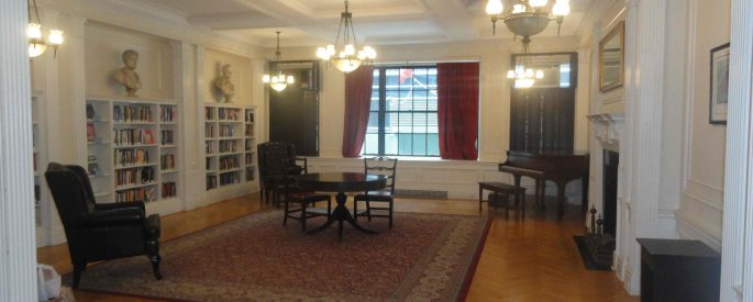 image of a reading room, a large room with a wooden floor and a large rug