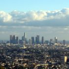 grainy, aerial photograph of the skyline of Los Angeles - smog hovers over the city and the clouds are low in the sky