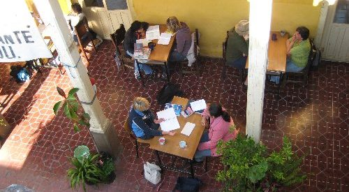 aerial photo of a couple at a table in a courtyard