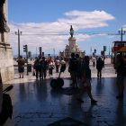 landscape photo of tourists in Lisbon, Portugal on a sunny day