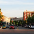 photo of Iowa City at golden hour, with bright golden light strewn across brick buildings