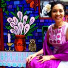 photo of Aurora Anaya-Cerda at La Casa Azul, she sits and smiles for the camera