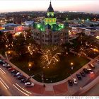 photograph of Denton Courthouse at night from an aerial view