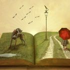Open book with abstract elements - a pen and coffee mug sit next to the book on the table, but leaping out of the open book are a hot air balloon, flying cranes; a lamp post, a child with a red umbrella, and hound dog
