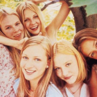 photo of the actresses from the virgin suicides posing together playfully in a tree