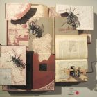 photo of an abstract 3D art piece that is constructed of books and wire sculptures of bugs