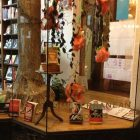 photo of a display in a bookstore, which is decorated by dangling roses