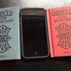 "two small copies of the books ""Dont's"" for Husbands and Wives lay beside an iPhone for comparison, showing that the two small marriage manuals are the size of an iPhone"