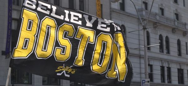 a Believe Boston glad in black and yellow color scheme