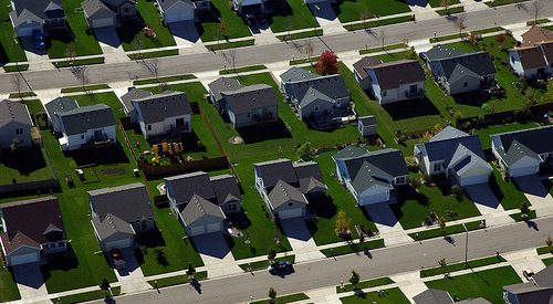 photo of rows of suburban, cookie-cutter houses, situated extremely close together