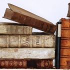stock photo image of old, antique books stacked on top of each other