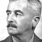 black and white headshot of William Faulkner who looks off into the distance