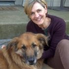 photograph of Ploughshares editor-in-chief Ladette Randolph posing with dog