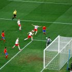 photograph of soccer players during the FIFA 2010 World Cup between Spain and Switzerland celebrate after a goal