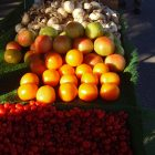photo of a mound of oranges at an outdoor market