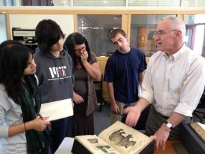 Stephen Skuce sharing a medieval bestiary with students at MIT