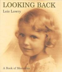 book cover shows a yellow hued image of a small girl with curly blond hair